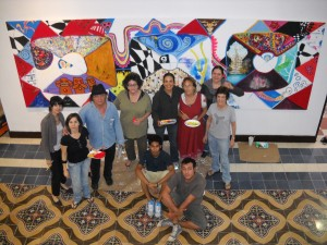 "In the ""Museo de la ciudad"" we have a large Col-Art-exhibitions,  and we realize with artists of Yucatan a Col-Art-canvas: Concept: M.Kuhn 150 / 300 cm   Acrylic /canvas In front of the picture we see some of the participants: Jorge Roy Sobrino, Sandra Nikolai, Rossana Duran, Claudia Jurado, Monica Lachese, Jorge Tillett, Deckenkodeak, Alonso Maza, Adela Isaac, Pilar Camara, Nada, Marc Kuhn."