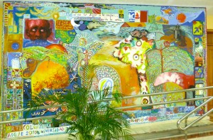 In the entrance of the cultural center of Adeje, we realized in 2010 a large Col-Art-mural with about 25 participants and within the frame of the Summer-University.  Some of the professional participants: -Conrado Diaz Ruiz, -Aixa,          -Siegfried Daniel, -Ariam Laforo, -Rossana Duran, -Caroline, Mathias and Marc Kuhn...                                                      Concept: M.K.              Acrylic on cement    300 / 500 cm      Title: Biodiversity